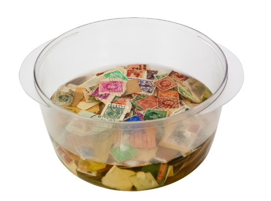 old stamps soaking in bowl